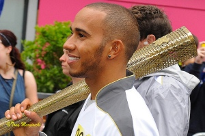 Lewis Hamilton in happier times. Or maybe he's looking to hit Rosberg over the head with this Olympic torch. Picture by Tony Maggiocchi.