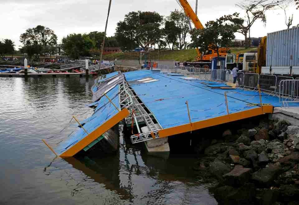 A ramp built for competitors' boats to reach the water hangs after collapsing at the Marina da Gloria in Rio de Janeiro